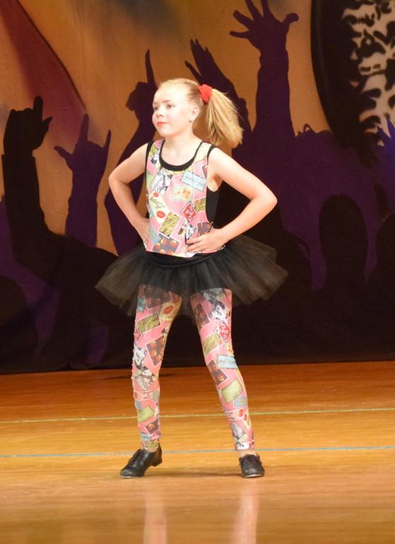 ". Morgan Lambert dances to \""Church of the Poison Mind\"" during Durante\'s Dance Studio\'s \""Dancing to the 80\'s\"" recital Saturday, June 9, 2018."