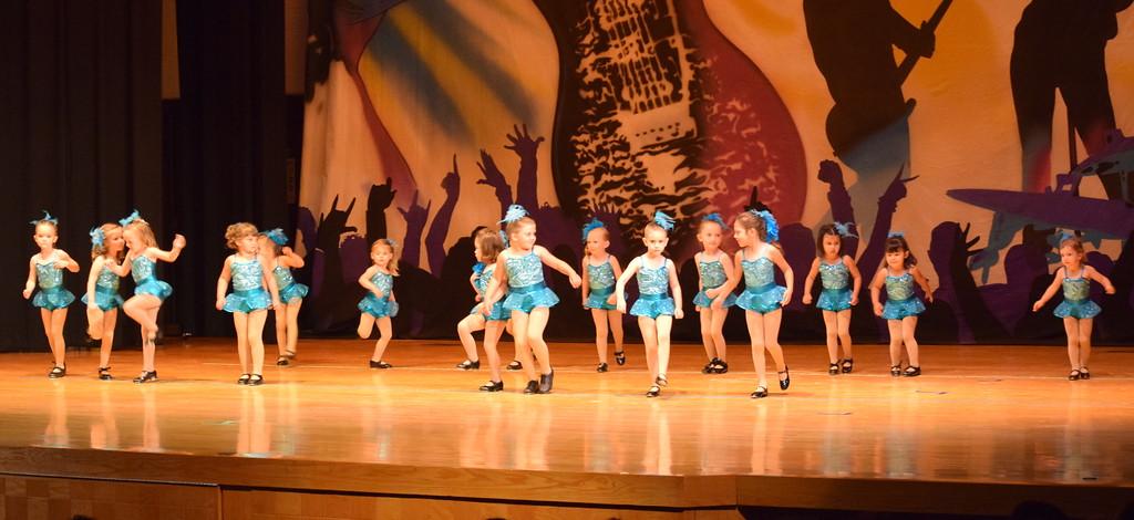 ". Tearsa Finley, Peyton Velk, Caroline Wright, Zoey McKay, Pacyn Stromberger, Adley Miller, Corryn Monheiser, Emma Lerdal, Quinn Seifried, Avery Goeglein, Faith Baray, Amiyah Steele, Kadance Hooton, Joy Soukup, Meritt Ringlein and Josy Schneoper dance to \""Wake Me Up Before We Go Go\"" during Durante\'s Dance Studio\'s \""Dancing to the 80\'s\"" recital Saturday, June 9, 2018."