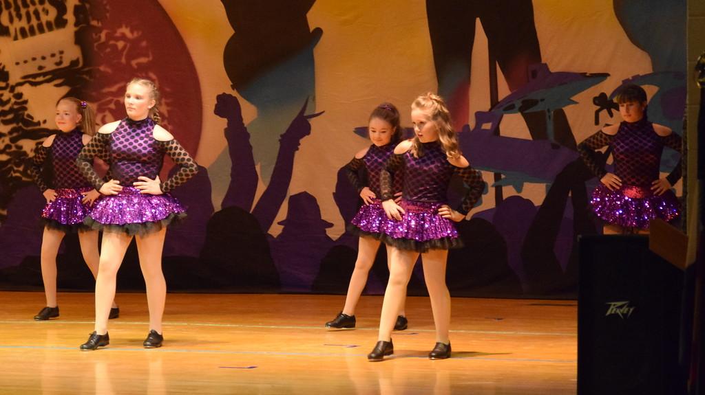". Courtney Canada, McKenzie Beck, Jaiden Reiman, Kami Neal, Marissa Kujala, Bailey Workman, Kaina Carrasco, Taryn Seifried and Morgan Lambert dance to \""One Thing Leads to Another\"" during Durante\'s Dance Studio\'s \""Dancing to the 80\'s\"" recital Saturday, June 9, 2018."