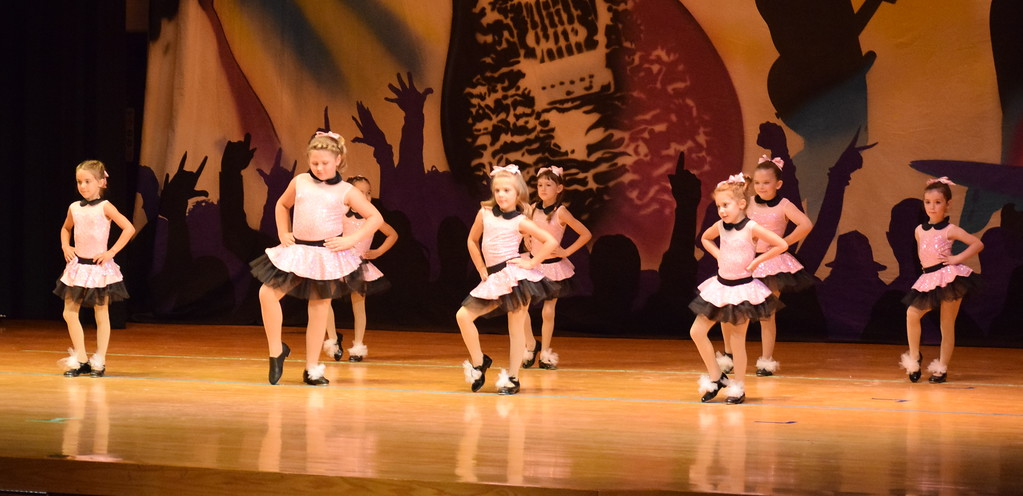 """. Darby Webb, Daisy Barkley, Layla Lopez, Katherine Archuleta, Mckenna Padilla, Haley Troyer, Haven Cox and Catherine Gerk dance to \""""Don\'t Be Cruel\"""" during Durante\'s Dance Studio\'s \""""Dancing to the 80\'s\"""" recital Saturday, June 9, 2018."""