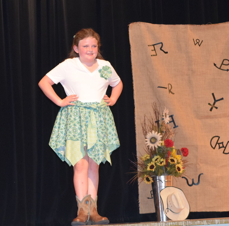 . Ailey Paxton models her bandana dress in the Junior Division of the Logan County Fair 4-H Fashion Revue Friday, Aug. 3, 2018.