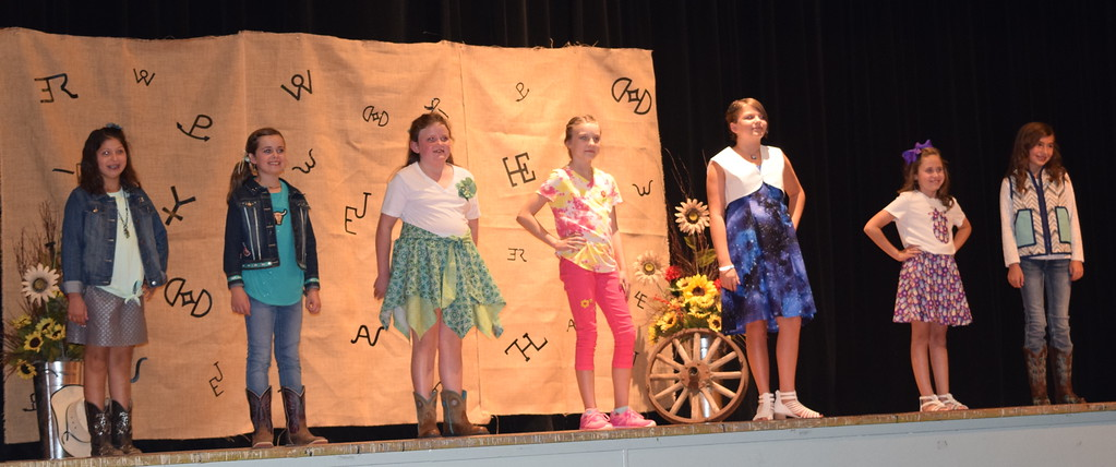. Contestants in the Junior Division of the Logan County Fair 4-H Fashion Revue Friday, Aug. 3, 2018, model their outfits. From left; Addison Koester, Hadley Stull, Ailey Paxton, Kayto Williams, Mattea Pelton, Taylor Tribbett and Alexis Gentry.