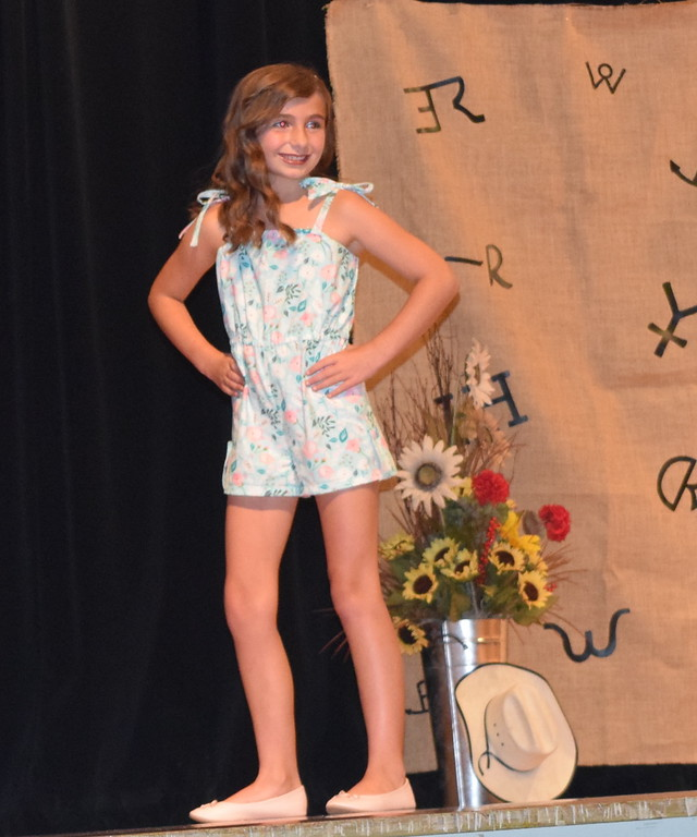 . Alexis Gentry models her jumper in the Encore Division of the Logan County Fair 4-H Fashion Revue Friday, Aug. 3, 2018.