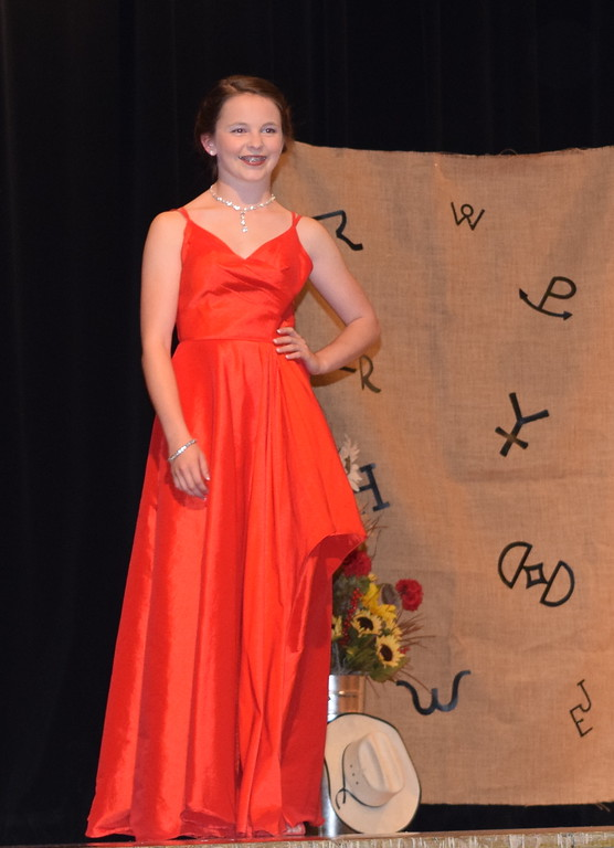 . Aly Young models her dress in the Encore Division of the Logan County Fair 4-H Fashion Revue Friday, Aug. 3, 2018. She was named champion in the division.