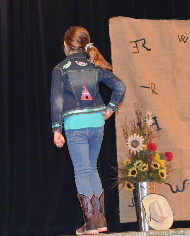 . Hadley Stull models her outfit in the Junior Division of the Logan County Fair 4-H Fashion Revue Friday, Aug. 3, 2018.