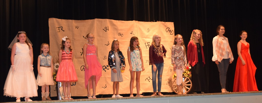 . Competitors in the Encore Division of the Logan County Fair 4-H Fashion Revue Friday, Aug. 3, 2018, model their outfits. From left; Ailey Paxton, Piper Withers, Taylor Tribbett, Natalie Adels, Livie Ziegler, Alexis Gentry, Sadie Fehringer, Ayla Baney, Ashton Nichols, Rachael Northup and Aly Young.