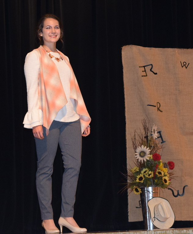 . Rachael Northup models her outfit in the Encore Division of the Logan County Fair 4-H Fashion Revue Friday, Aug. 3, 2018.