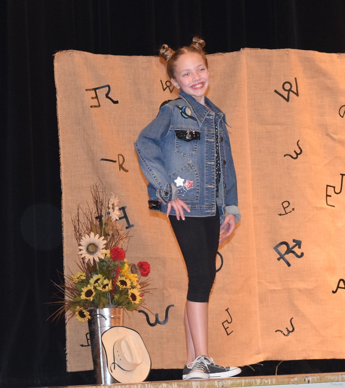 . Ayla Baney models her outfit in the Intermediate Division of the Logan County Fair 4-H Fashion Revue Friday, Aug. 3, 2018. She was named Champion in the division.