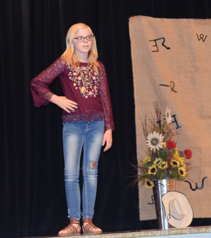 . Sadie Fehringer models her oufit in the Encore Division of the Logan County Fair 4-H Fashion Revue Friday, Aug. 3, 2018.