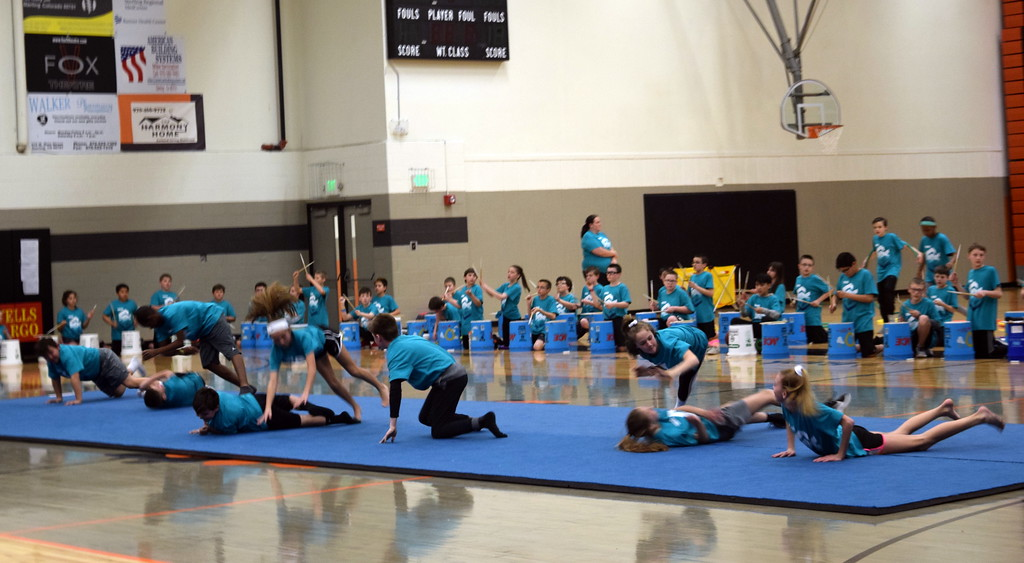 """. Students show off their athletic skills as they jump over each other to the song \""""Thunderstruck\""""  at Campbell Elementary\'s annual 5th Grade Music and P.E. Showcase Tuesday, March 12, 2019."""