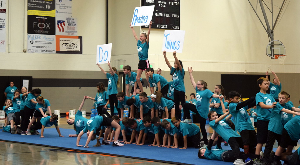 """. Campbell Elementary fifth grade students send a message to \""""Do Amazing Things\"""" as they form pyramids to the song \""""Have it All\"""" during the school\'s annual Music and P.E. Showcase Tuesday, March 12, 2019."""