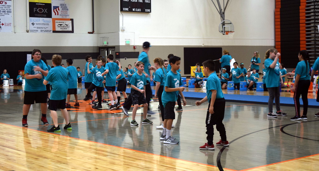 """. Campbell Elementary fifth graders show off their secret handshakes to the song \""""Classic\"""" during the annual 5th Grade Music and P.E. Showcase Tuesday, March 12, 2019, directed by Janelle Nicolaus, music teacher; Coach Judy Beardsley; and Coach Tyler Blood, P.E. para."""