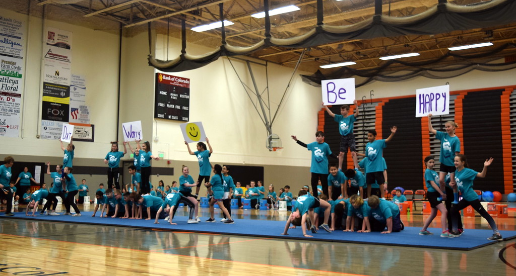 """. Students form pyramids to the song \""""Don\'t Worry Be Happy\"""" during Campbell Elementary\'s annual 5th Grade Music and P.E. Showcase Tuesday, March 12, 2019, at Sterling High School. The show was directed by Janelle Nicolaus, music teacher; Coach Judy Beardsley; and Coach Tyler Blood, P.E. para."""