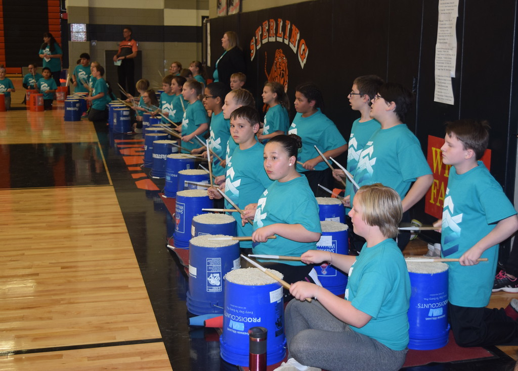 . Fifth graders show off their drumming skills using buckets at Campbell Elementary\'s annual Music and P.E. Showcase Tuesday, March 12, 2019.