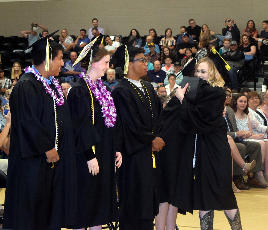 . Jamie Kielian is congratulated by her fellow graduates after receiving her diploma at Caliche High School\'s Commencement Ceremony Saturday, May 25, 2019.