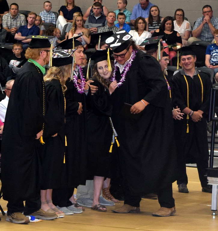 . Clayton Funkhouser is congratulated by his fellow graduates after receiving his diploma at Caliche High School\'s Commencement Ceremony Saturday, May 25, 2019.