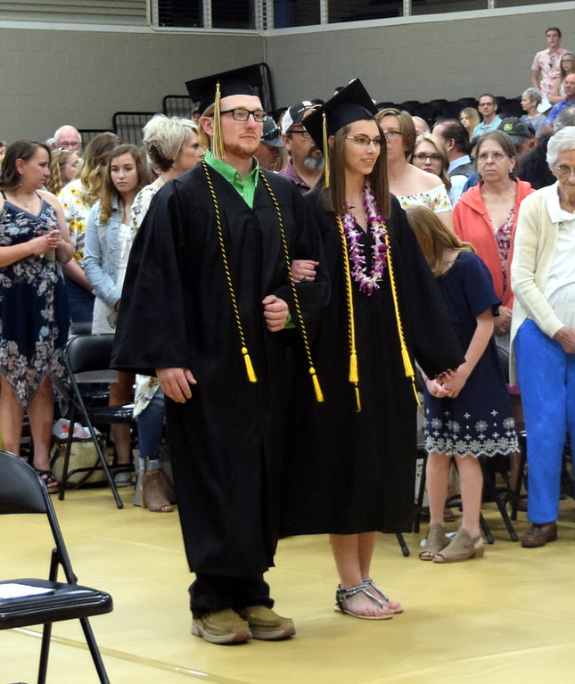 . Tate Green and Kenzie Grauberger make their way to their seats at Caliche High School\'s Commencement Ceremony Saturday, May 25, 2019