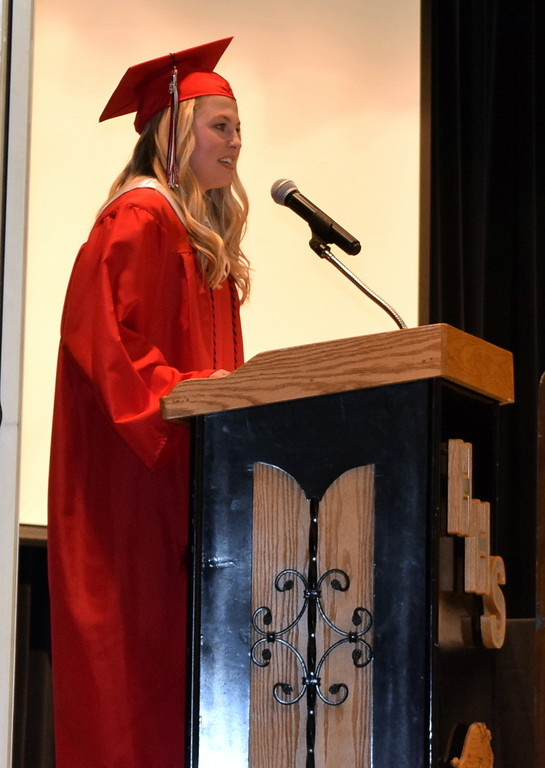 . Haxtun High School graduate Riley Thompson presents the class gift, funding for a new sign in front of the school, during commencement Sunday, May 19, 2019.