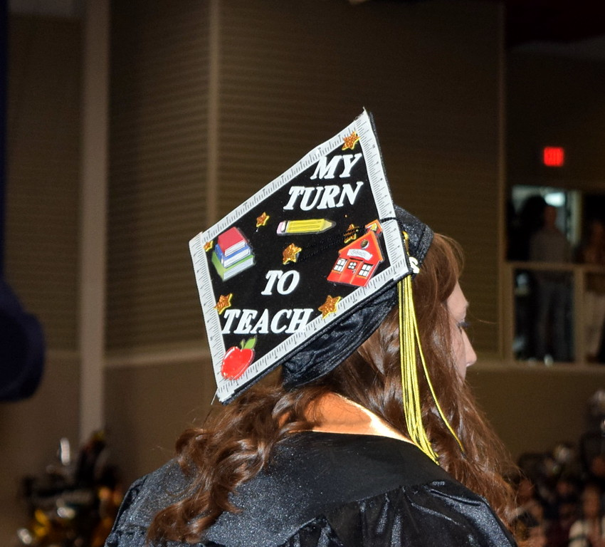". ""My turn to teach\"" reads the cap of one of the graduates  at the Northeastern Junior College Commencement Ceremony Friday, May 17, 2019."