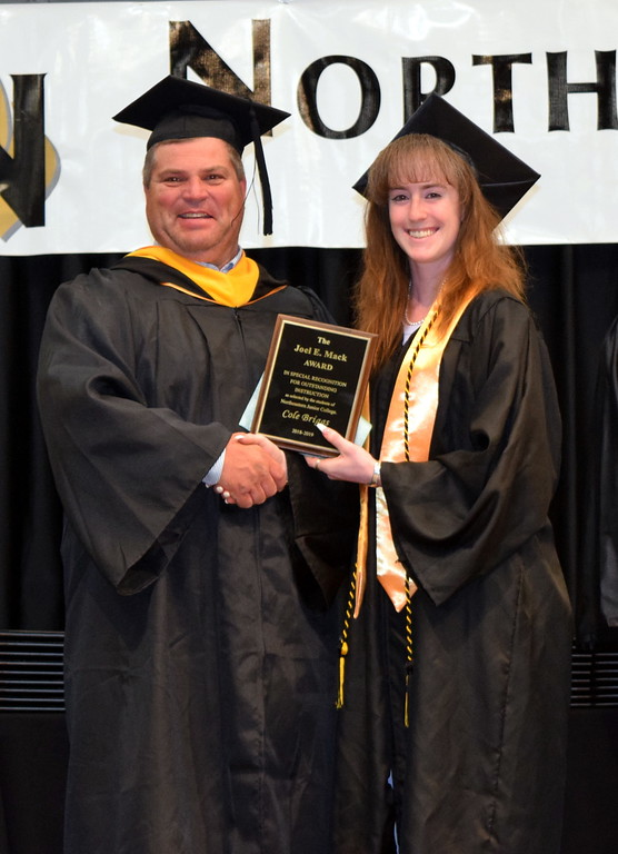 . Northeastern Junior College Associated Student Government Second Vice President Amy Crowder presents the Joel E. Mack Award to Cole Briggs, equine management coordinator, at NJC\'s Commencement Ceremony Friday, May 17, 2019.