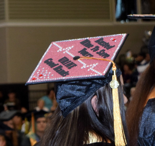 ". ""Busted mine to save yours...urine good hands\"" reads the cap of one of the nursing graduates at Northeastern Junior College\'s Commencement Ceremony Friday, May 17, 2019."