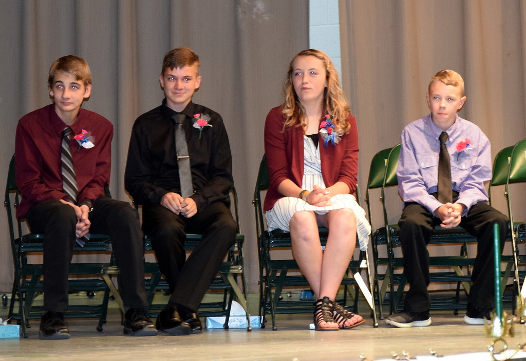. Peetz School\'s Continuation Class of 2019 listens to remarks at the Continuation Exercises Sunday, May 12, 2019. From left; Colton Howell, Steele Maas, Alexandria Nienhuser and Brayden Weinbender.