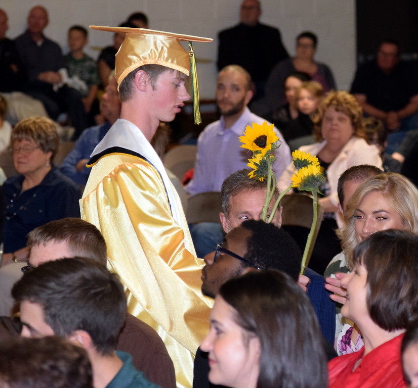 . Kyler Speer hands out flowers to family and friends at Peetz School\'s Commencement Ceremony Sunday, May 12, 2019.