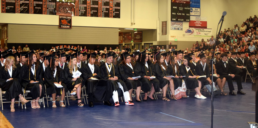 . Sterling High School graduates listen to a speaker at the commencement ceremony Saturday, May 25, 2019. This year\'s class has 119 graduates.