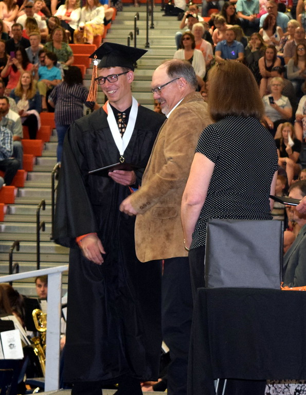 . Bryce Gilliland, who was severely injured in a car accident last June, smiles as he receives his diploma at Sterling High School\'s Commencement Ceremony Saturday, May 25, 2019.
