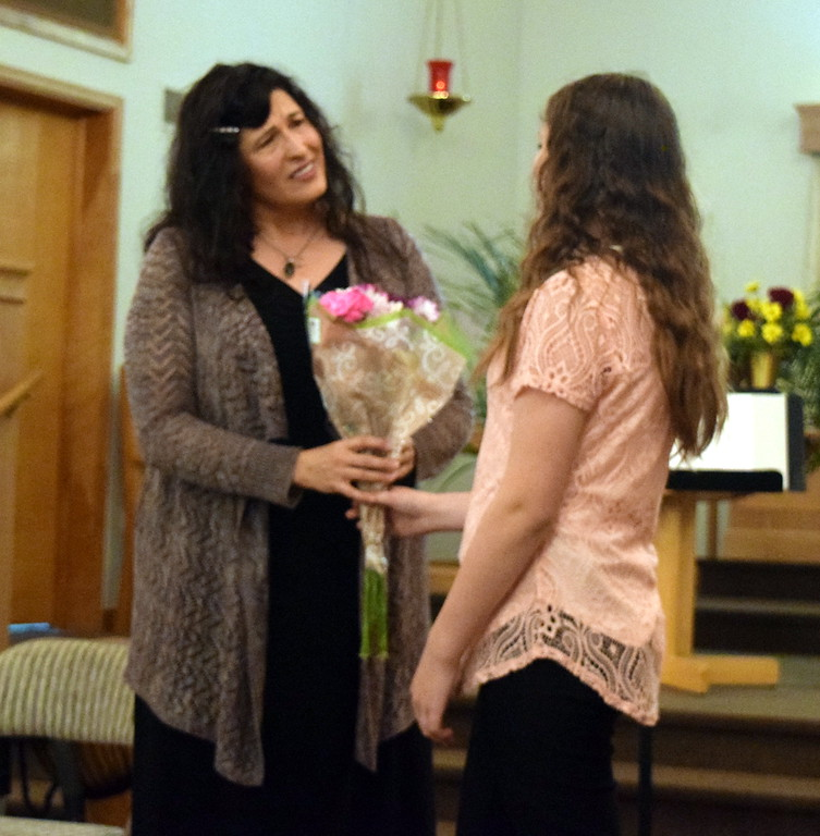 . Darla Korrey accepts flowers from one of her students, Mikayla von Steinman, at the conclusion of a Recital of the Harmoic Horizons Conservatory and Studio of Darla Korrey Sunday, April 28, 2019.