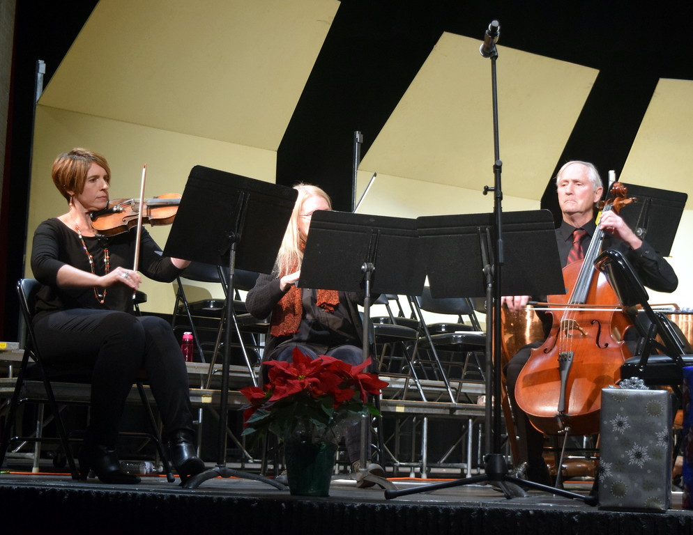 ". The Sterling String Trio, Olivia Courtney, Holly Evans and Phil Found perform at Master Chorale\'s ""27th Noel\"" Christmas Concert Sunday, Dec. 9, 2018."