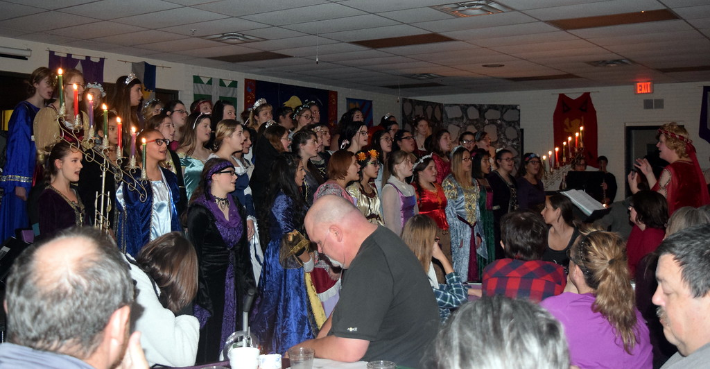 """. The Sterling High School Women\'s Chori performs \""""Bring a Torch, Jeannette Isabella\"""" during the school\'s Madrigal Dinner Monday, Dec. 3, 2018."""