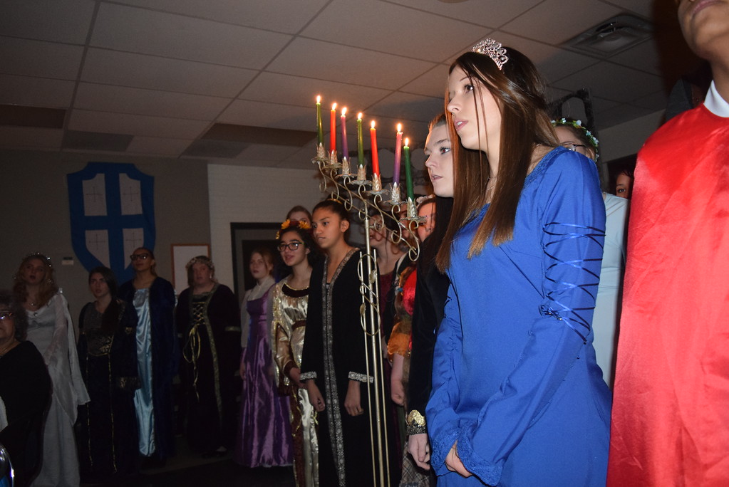 """. Sterling High School choir students sing \""""Masters in This Hall\"""" during the school\'s Madrigal DInner Monday, Dec. 3, 2018."""