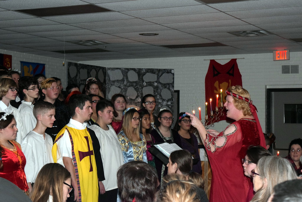 """. Director Annette Lambrecht gives the Sterling High School Mixed Choir a cue during their performance of \""""Antiphonal Deck the Hall\"""" at the school\'s Madrigal Dinner Monday, Dec. 3, 2018."""