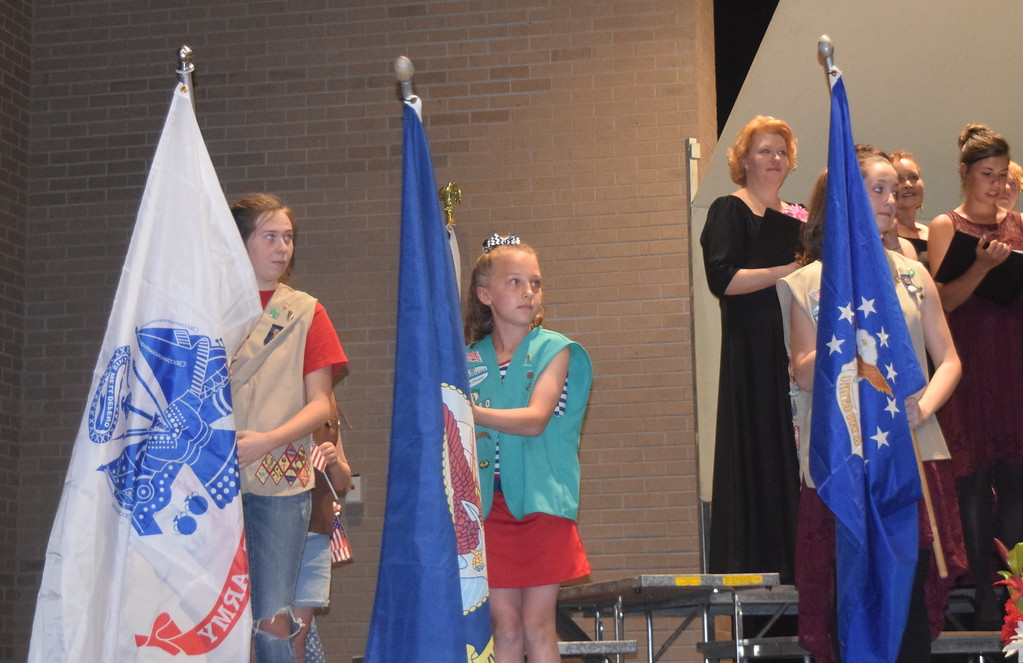 """. Members of Girl Scout Troops #76180, 73910 and 82586 hold up flags for each branch of the military during Master Chorale\'s performance of \""""Armed Forces- The Pride of America!\"""" at the chorale\'s 28th annual Spring Concert Sunday, May 5, 2019."""