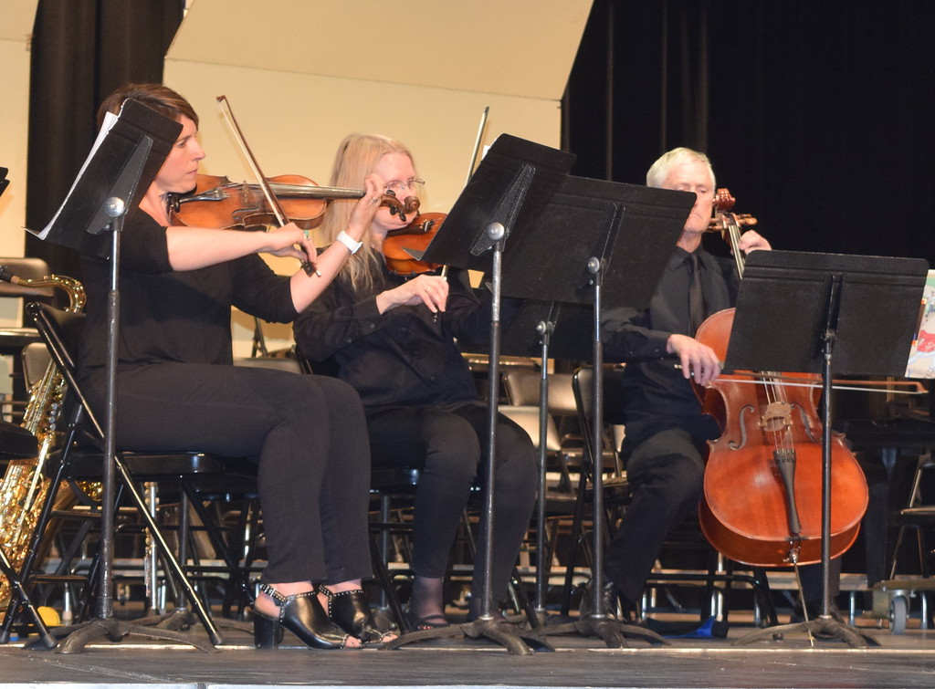 . A string trio, from left, Olivia Courtney on violin, Holly Evans on viola and Phil Found on cello, perform during intermission of Master Chorale\'s 28th annual Spring Show Sunday, May 5, 2019.