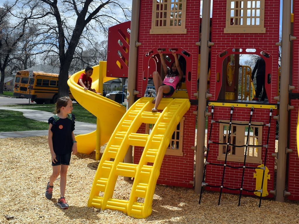 . Merino Elementary fifth graders have fun playing on the new fire department-themed playground equipment that was formally opened during the city of Sterling\'s Arbor Day celebration Friday, April 26, 2019.