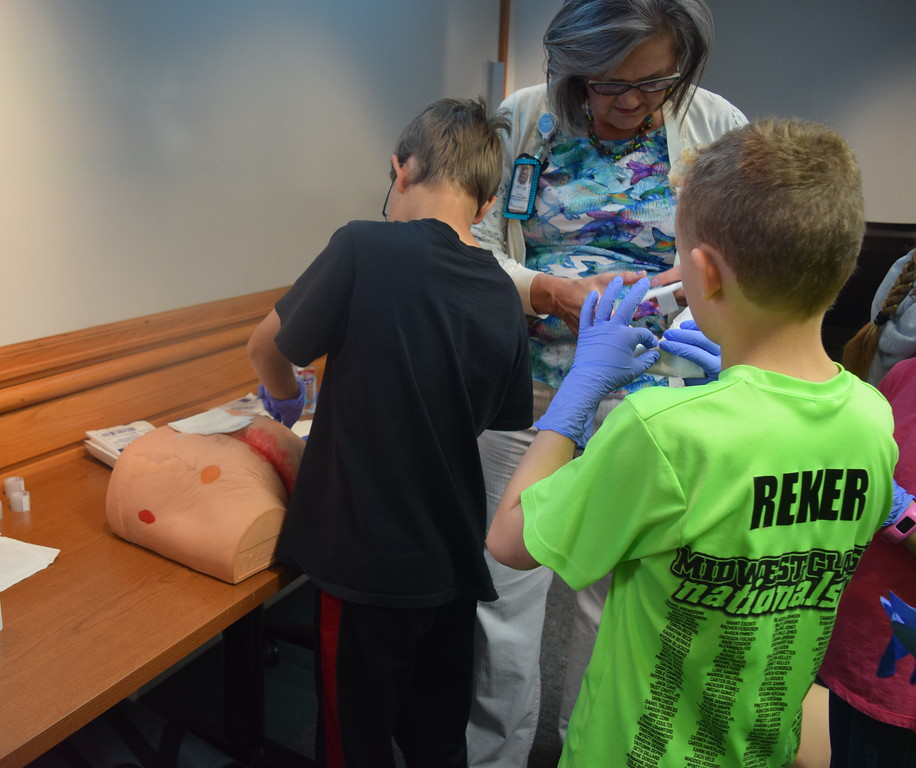 . Logan County third graders learned how to dress a wound as part of a tour of Sterling Regional MedCenter Wednesday, April 24, 2019.