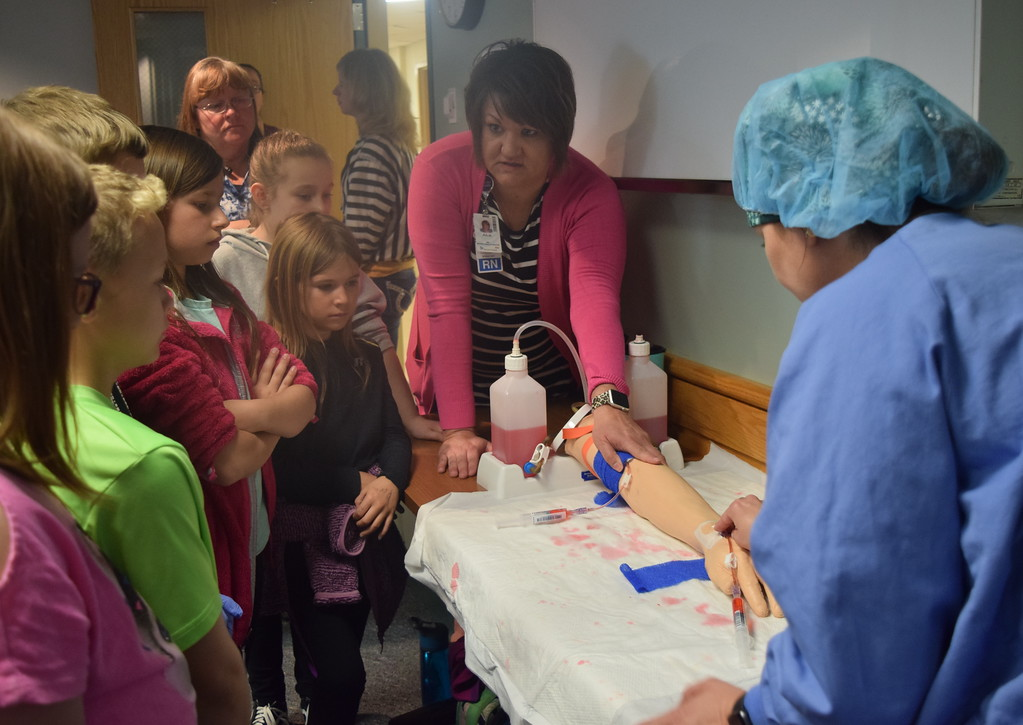 . Caliche, Fleming, Merino and Peetz third graders learn how to put an IV into an arm during a tour of Sterling Regional MedCenter Wednesday, April 24, 2019.