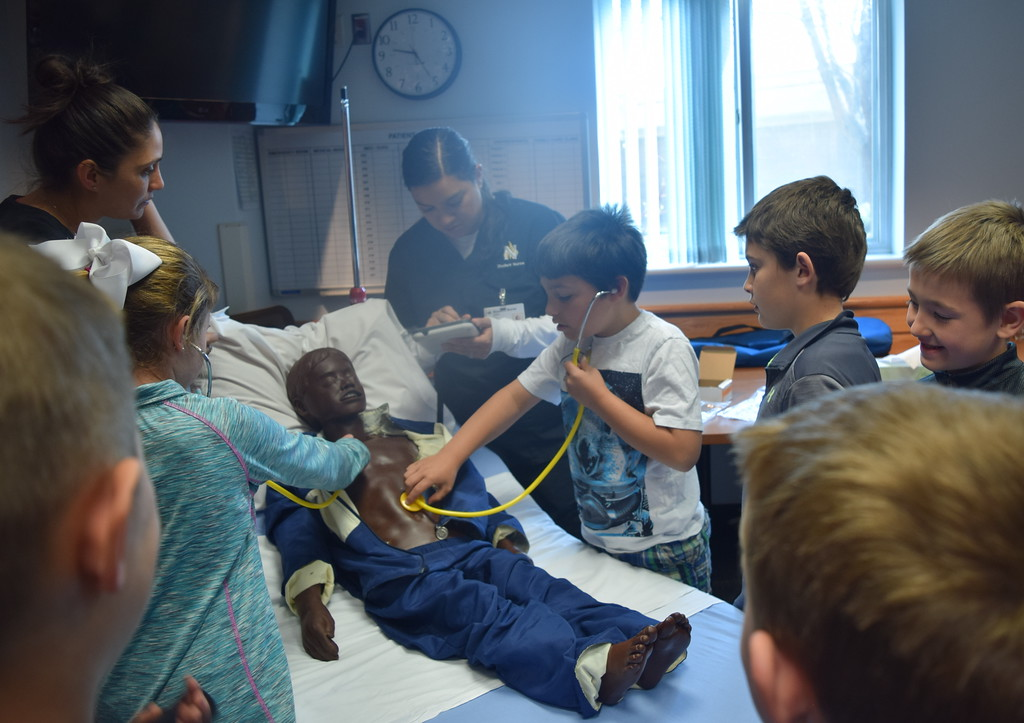 . Northeastern Junior College nursing students help area third graders listening to the heartbeat of a mannequin patient during a tour of Sterling Regional MedCenter Wednesday, April 24, 2019.
