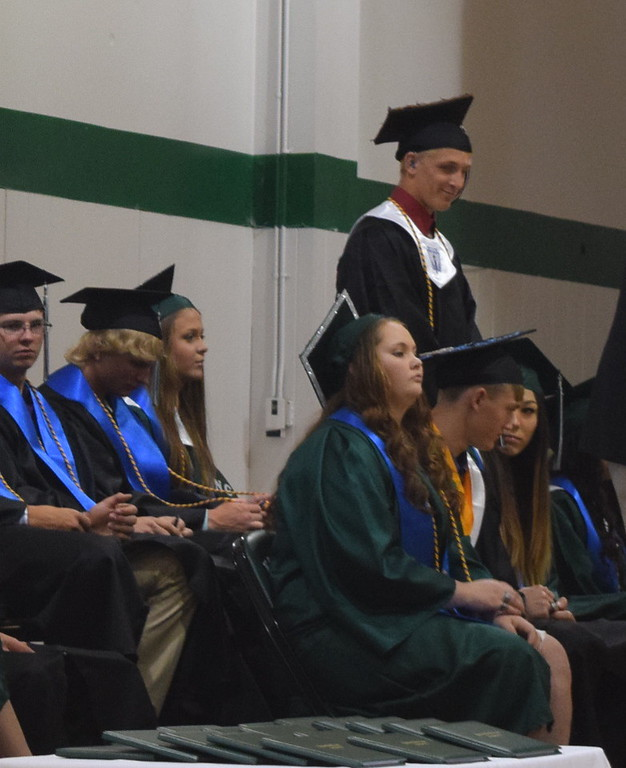 . Levi Muller stands as he is recognized during Fleming High School\'s commencement ceremony Sunday, May 14, 2017.