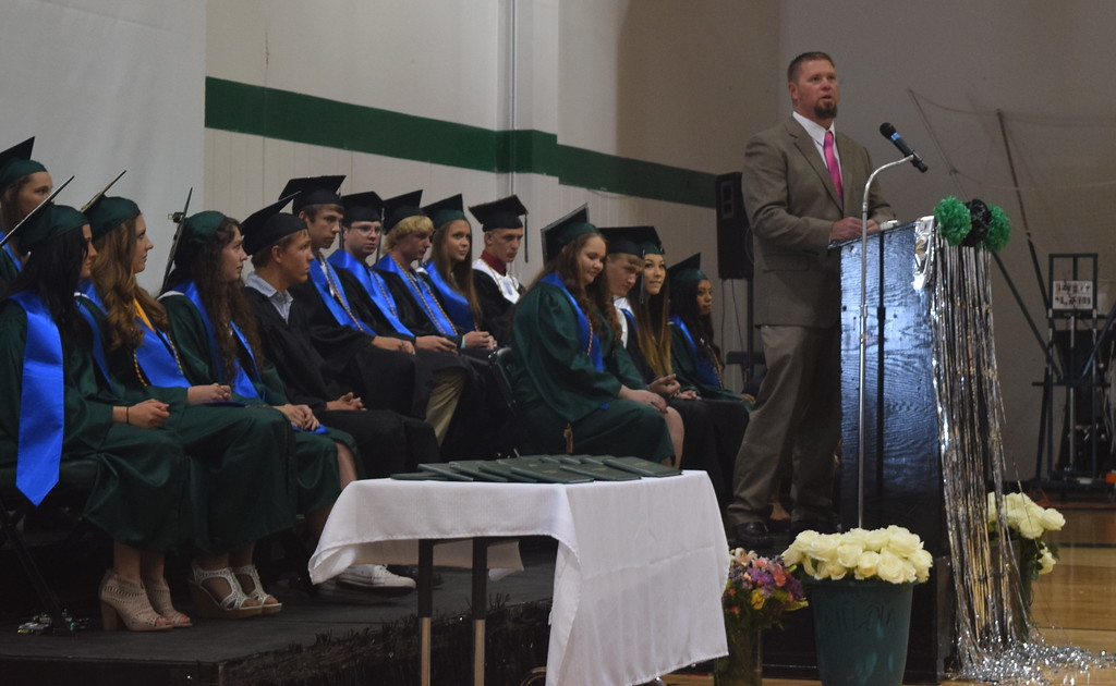 . Gary Harms prepares to give the invocation at Fleming High School\'s commencement ceremony Sunday, May 14, 2017.