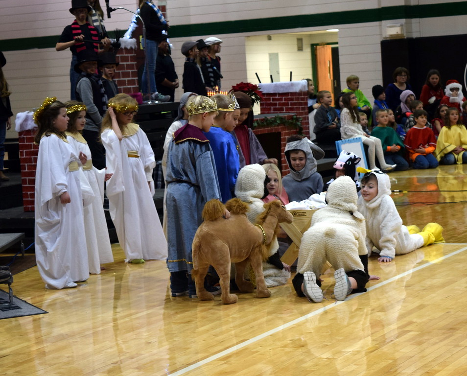 """. Fleming Elementary second through fourth graders depict the nativity scene as their classmate\'s sing \""""Just a Tiny Baby\"""" during the school\'s production of \""""Once on a Housetop\"""" Monday, Dec. 11, 2017."""