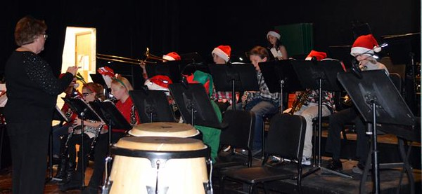 """. he Fleming Sixth Grade Band plays \""""Banana Boat Song\"""" during the school\'s Christmas program. The band also performed \""""Up On the Housetop,\"""" \""""Jolly Old St. Nicholas\"""" and \""""Clip, Clop, Clap.\"""""""