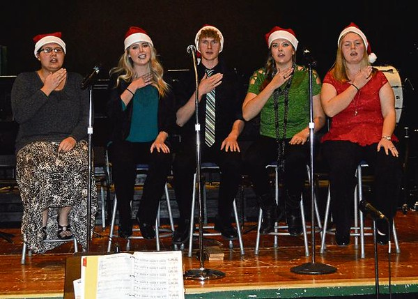 """. The Fleming High School Choir performs \""""White Winter Hymnal\"""" during the school\'s Christmas program. The quintet also performed \""""Sleigh Ride\"""" and an antiphonal version of \""""Deck the Halls.\"""" Garrett Cockroft, center, performed \""""Ave Maria\"""" as a solo. From left are Shyunika Wilson, Aly Sprague, Garrett Cockroft, Brooke Sigmon and Lauren Whittington."""