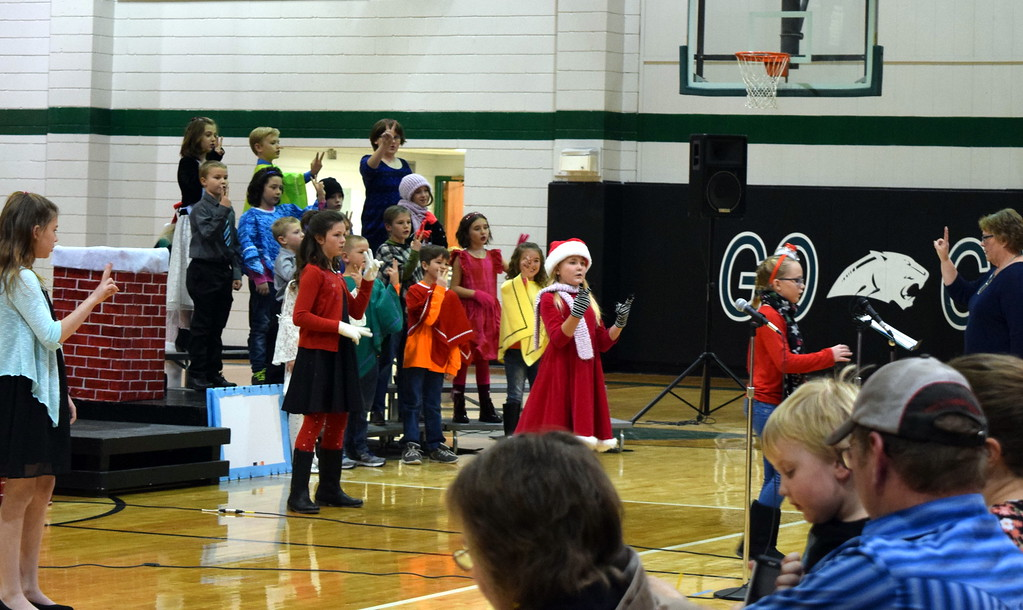 """. Second through fourth grade students sing the opening number, \""""Once on a Housetop,\"""" under the direction of Jeri Anderson, during Fleming Elementary\'s production of \""""Once on a Housetop\"""" Monday, Dec. 11, 2017."""