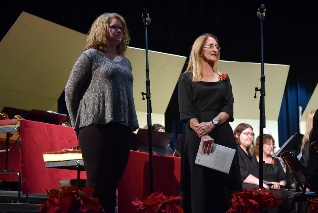 . Master Chorale member Linda Batty, right, introduces Victoria Krier, the choir\'s latest Northeastern Junior College music student scholarship recipient prior to the start of the group\'s 26th Noel Christmas Concert Sunday, Dec. 10, 2017.