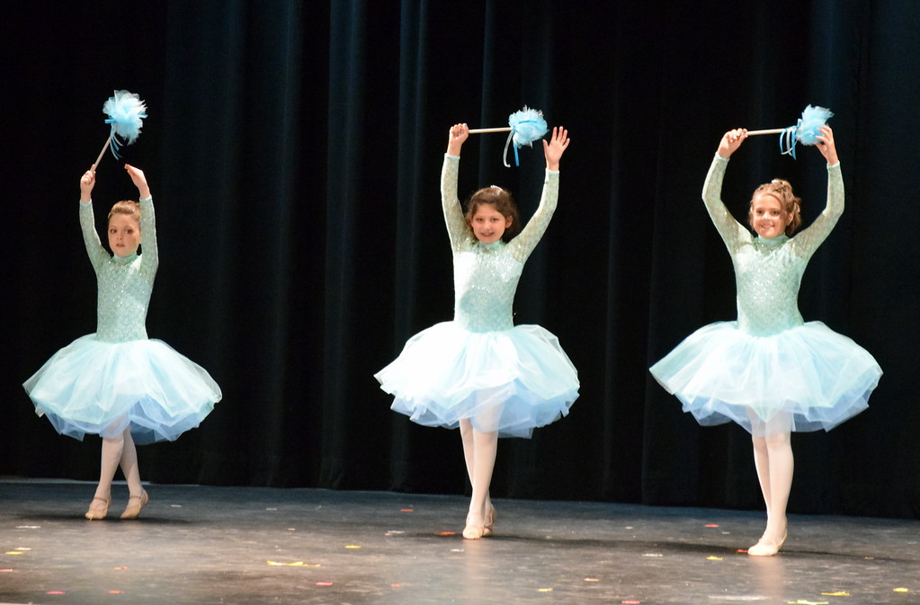 """. Chloe Hutcheson, Addison Koester and Abigail Kelley dance to \""""Bippity Boppity Boo\"""" at Melissa\'s School of Dance and Gymnastics\' \'Dance In Motion\"""" recital Wednesday, June 13, 2018."""