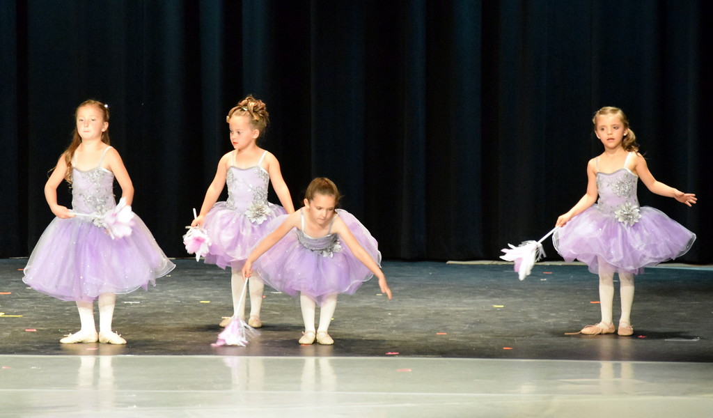 """. Ballerinas dance to \""""Cinderella-The Work Song\"""" at Melissa\'s School of Dance and Gymnastics\' \""""Dance in Motion\"""" recital Wedneday. Front row, Madison Nolan, left and Ruby Santisteven; back row, Monic Weis, left, and Mariah Perez."""