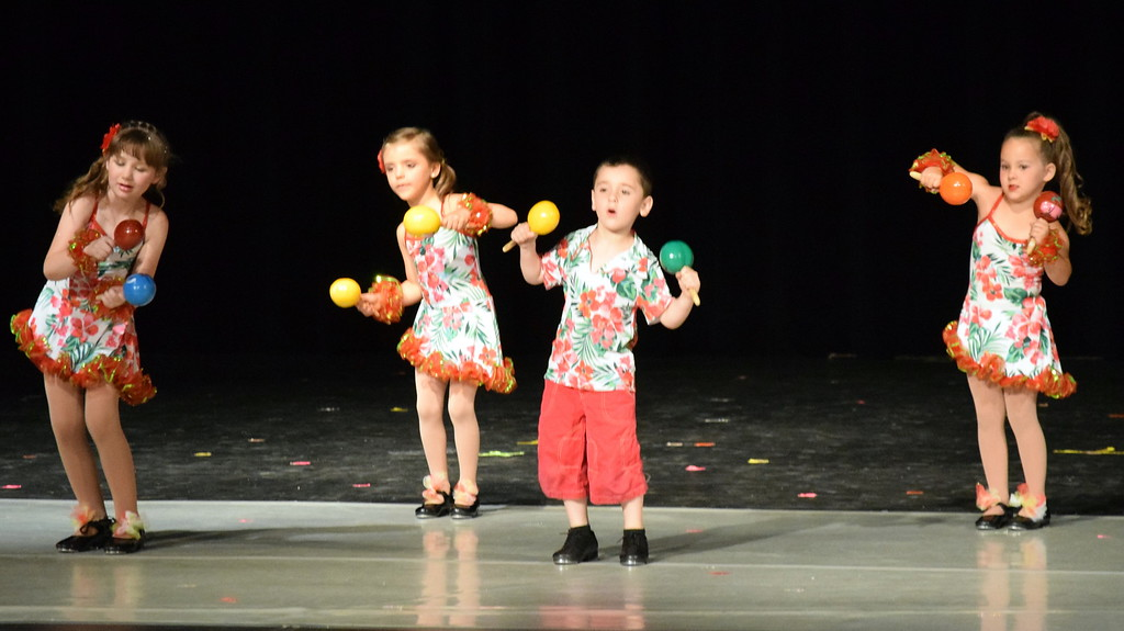 """. Dancers perform to \""""Chihuahua\"""" at Melissa\'s School of Dance and Gymnastics\' \""""Dance In Motion\"""" recital Wednesday, June 13, 2018. Front row, Ashtyn Fuller, left, Matthew Baird, back row; Victoria Hulbert, Monic Weis."""